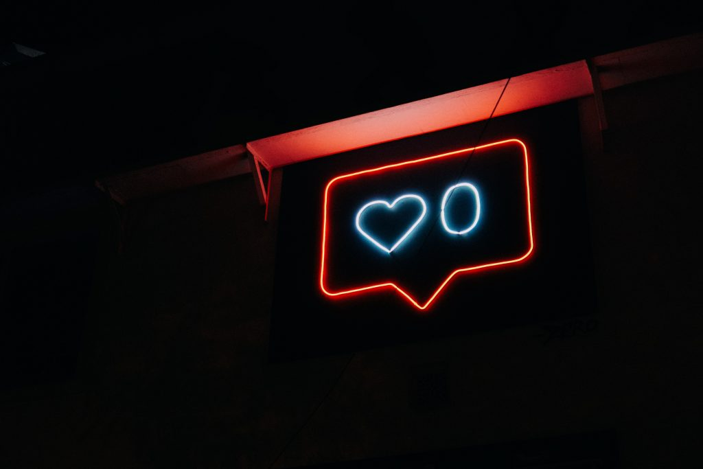 neon sign with a heart and zero next to it