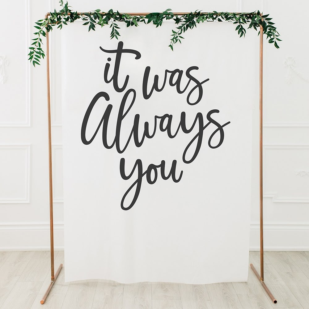 proposing large tapestry reading 'It was always you'